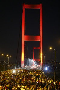 Pro-government demonstrators march over the Bosphorus Bridge, from the Asian to the European side of Istanbul, Turkey, July 21, 2016. REUTERS/Osman Orsal