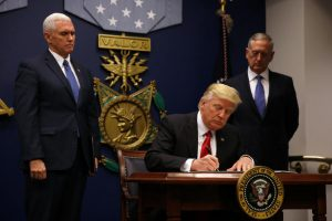 U.S. President Donald Trump signs an executive order he said would impose tighter vetting to prevent foreign terrorists from entering the United States at the Pentagon in Washington, U.S., January 27, 2017. REUTERS/Carlos Barria